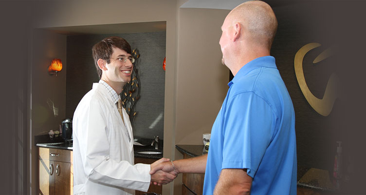 Doctor shaking hands with new patient.